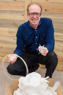 Pearce holding 3d printer filament created from recycling plastic milk jugs