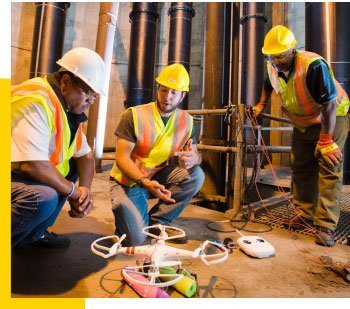 Three of MTRI's 60 employees.