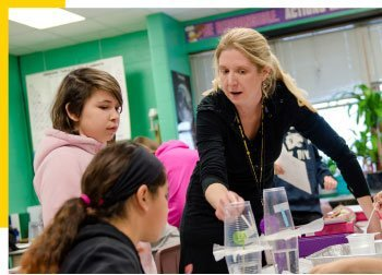 Jennifer Martin, L'Anse Jr/Sr High School, embraces hands-on science learning with her sixth-grade students by using new curriculum.