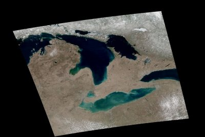 A satellite image of the Great Lakes shows green and blue areas of plant productivity.