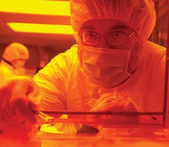 Paul Bergstrom works in the clean room in the Microfabrication Facility.