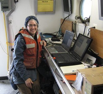 "Chemistry Professor Sarah Green crunches numbers aboard the R/V Laurentian, which tows a ""donut"" collecting data on plankton and water parameters."