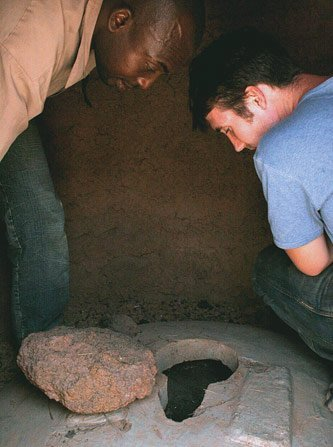 Yakoubu Yussif (left) and James Dumpert '08 inspecting some ventilated improved pit latrines in a small village in northern Ghana.