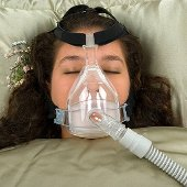 Person wearing CPAP mask.
