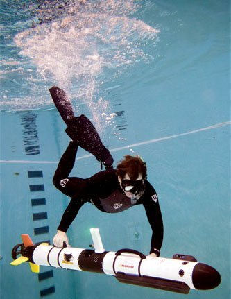 Researcher Colin Tyrrell chaperones Michigan Tech?s AUV in the University diving pool.
