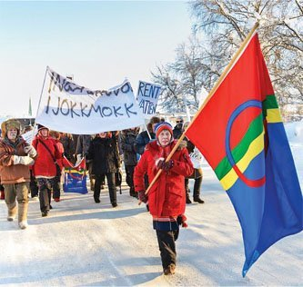 Sámi people protest plans to build an open-pit iron mine that would disrupt their reindeer's grazing and migration.