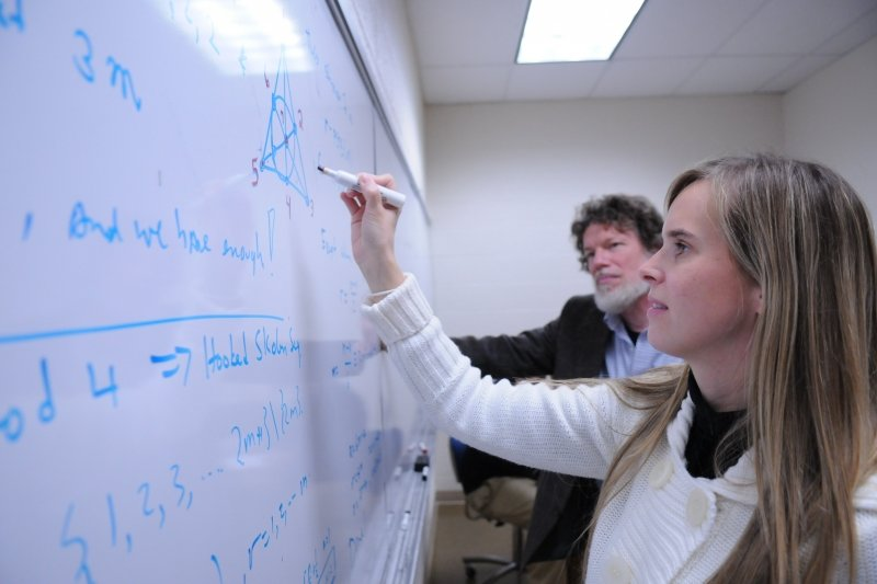 Two faculty solving equations
