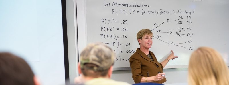 Dr. Beth Reed lecturing in a Statistics course