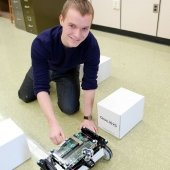 Student working on a small robot