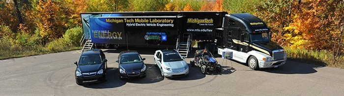 Mobile lab semi parked behind fuel efficient vehicles