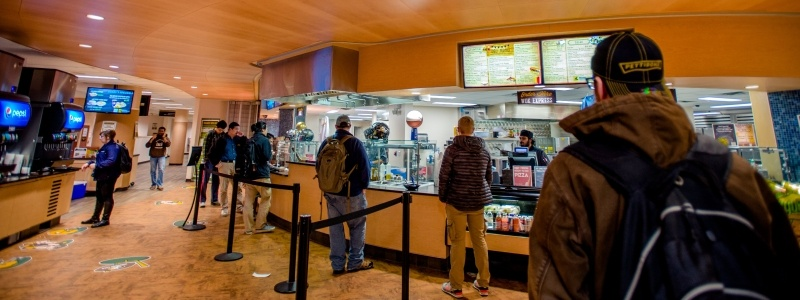 People ordering food at the North Coast Grill and Deli in the Memorial Union