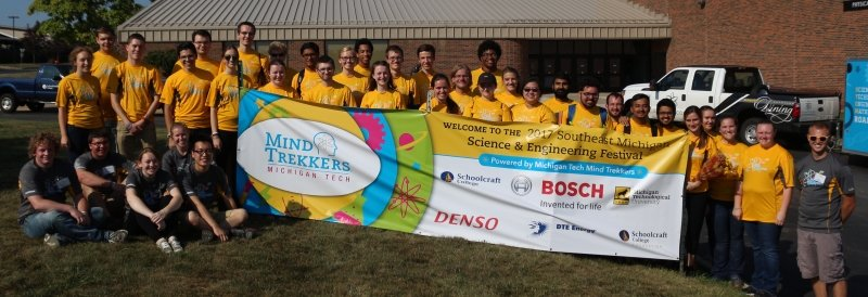 The Mind Trekkers team with a sponsors banner.