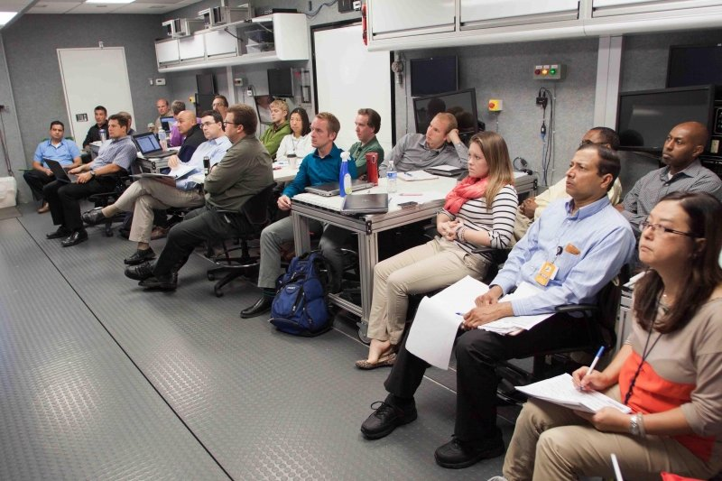 Participants watch a lecturer speak inside the Mobile Lab.