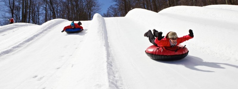 Patrons sliding down the tubing park lanes.