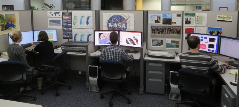 People sitting at computer stations.