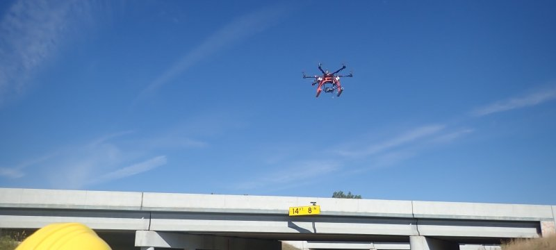 Hexcopter flying above a bridge.