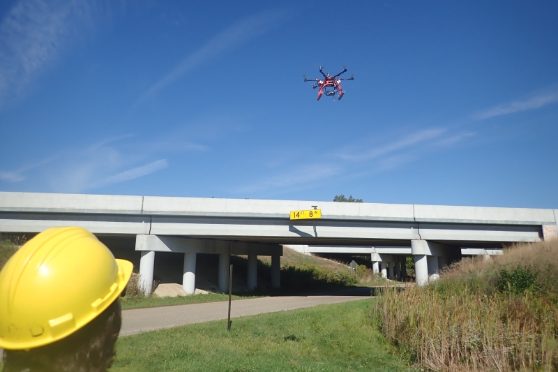 Hexacopter flying over a bridge.