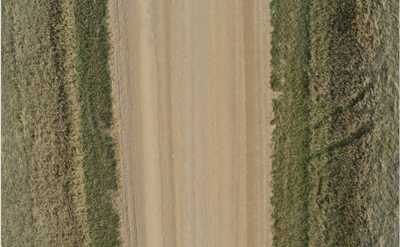 Aerial view of an unpaved road.
