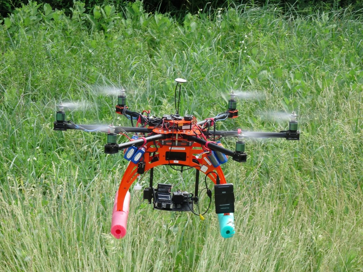 Hexcopter hovering above a field.