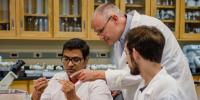 Thomas Werner and students in fruit fly lab.