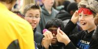 Middle school students from North Carolina react to one of the displays by Michigan       Tech's Mind Trekkers at a STEM festival in 2018. About 40 Michigan Tech undergraduate       and graduate students will volunteer to work the festival again this year during spring       break.