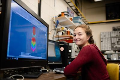 A student looking at a computer simulation.