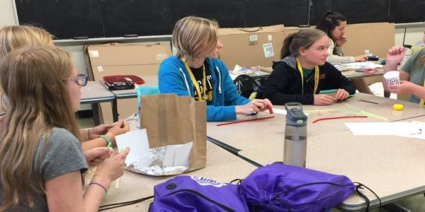 Participants in a 2018 Women in Engineering Program work on a team project. Thanks       to a $40,000 gift from ITC Holdings Corp., 40 middle-school girls will attend Junior       Women in Engineering.