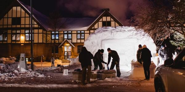 Members of Guardians of the North put the final touches on their statue during the       2019 All-Nighter.