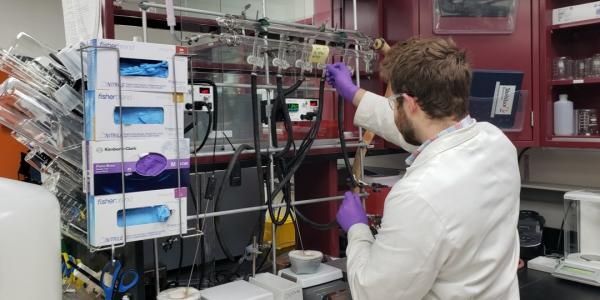 Joel Holland, a laboratory engineer at StabiLux, prepares the affinity chromatography       setting. Image Credit: StabiLux
