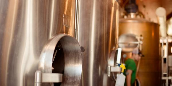 The fermentation vessels Huskies use in a new brewing course aren't nearly as large       as the tanks at Keweenaw Brewing Company—but they get a chance to see the craft on       a larger scale during a tour of the alumni co-owned brewery.