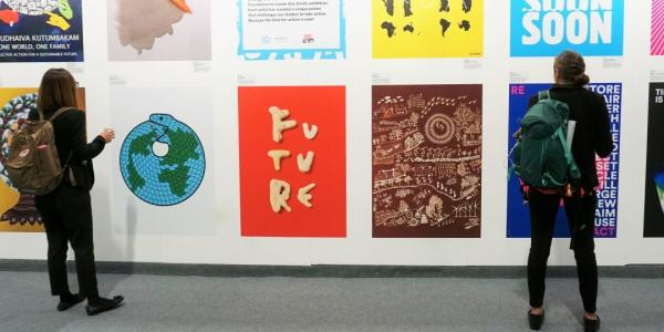 Students observe an art installation in one of the halls at COP25. Image Credit: Jessica       Daignault