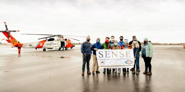 The SENSE Enterprise Team rendezvoused with the US Coast Guard at Houghton County       Memorial Airport to hear mission stories and collaborate with pilots, mechanics and       swimmers about the mass rescue craft the team is designing.