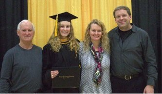 From left, Michael Young, his granddaughter Alyssa Smith, and her parents Leora and Brett Smith pose following Alyssa's graduation from Michigan Tech in December of 2014. All are Tech grads.
