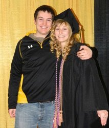 From left, Kealy and Alyssa Smith pose at Alyssa's graduation with a graduate degree from Michigan Tech. Healy who is also a Tech alumni, The siblings are the fourth generation in their family to attend Michigan Tech.