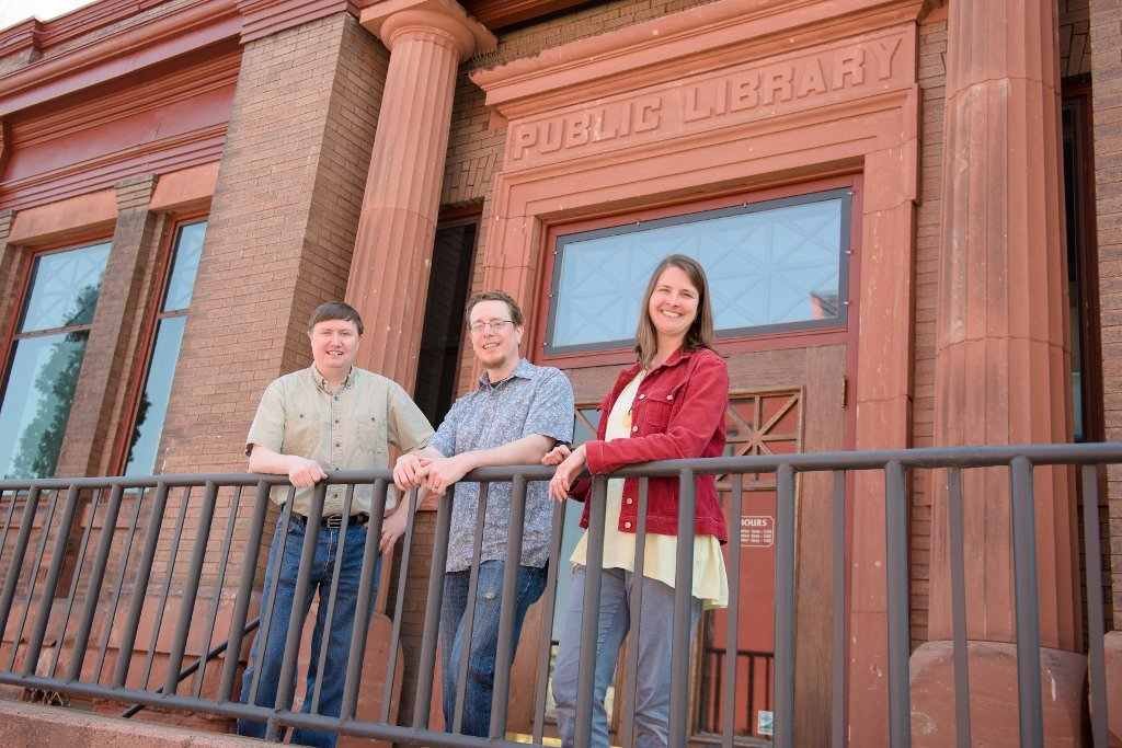 From left, Don Lafreniere, John Arnold and Sarah Scarlett are scene in front of one of their cooperating sites, Houghton's Carnegie Museum. Their project, Keweenaw Time Traveler, has received a $259,882 grant from the National Endowment of the Humanities.