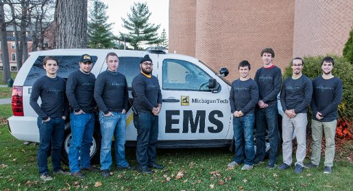 Student EMS volunteers who helped during Mark Calabria's heart attack. From the left: Theodore Kretzmann, Mike Sommers, Kyle Huyser, Ramandeep Rekhi, Ross Michaels,Jesse Olson, Mario Calabria, Jackson Burek.
