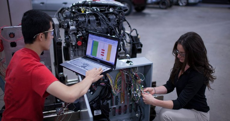 Phd candidate Simon Wang and undergraduate Katy Hickey setting up an open-architecture control system for engine combustion system development.