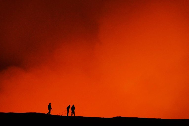 Smoke glows orange above the seven and half mile-wide caldera of the volcanic island Ambrym in the Islands of Vanuatu in the South Pacific. August 2014. Credit: Simon Carn / Michigan Technological University
