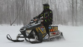 A rider on Michigan Tech's electric sled.