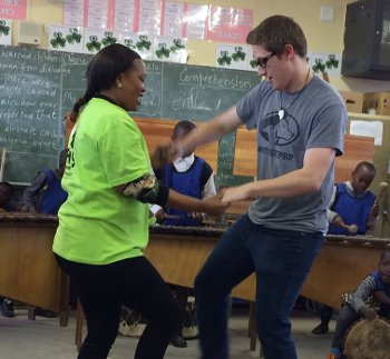 Michigan Tech student Spencer Carlson learns some moves during the Michigan Tech Concert Choir's tour of South Africa in May.