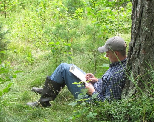 John Wheeler journaling in the woods