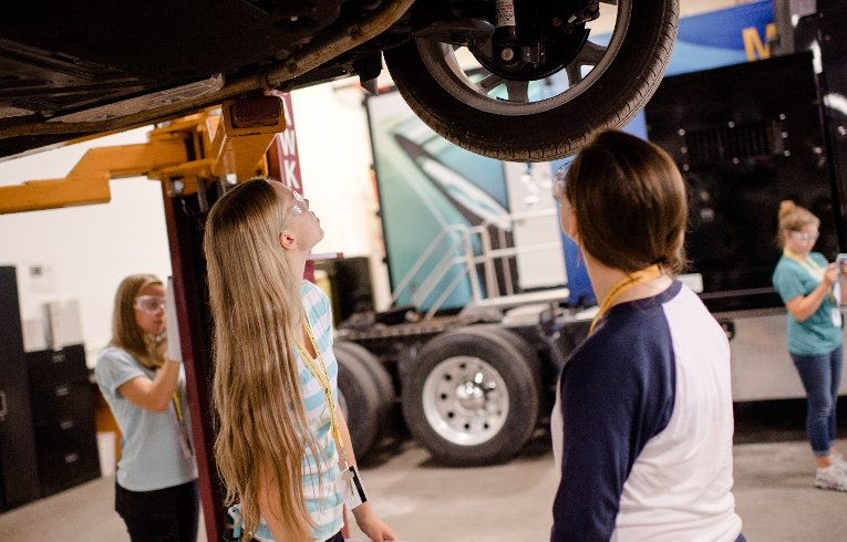 Girls in the Women in Automotive Engineering class discover the inner workings of vehicles.