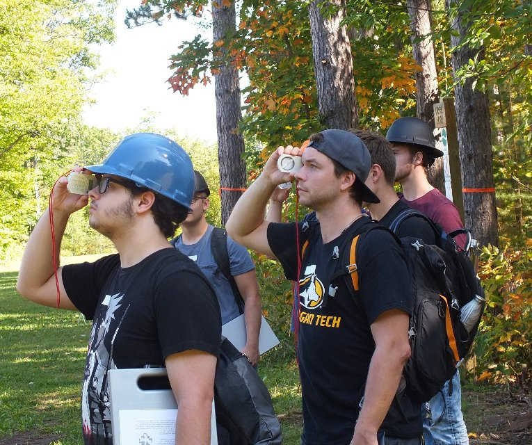 Students eyeball tree height using clinometers. The field techniques course is composed of 14 labs covering natural resources management essentials.