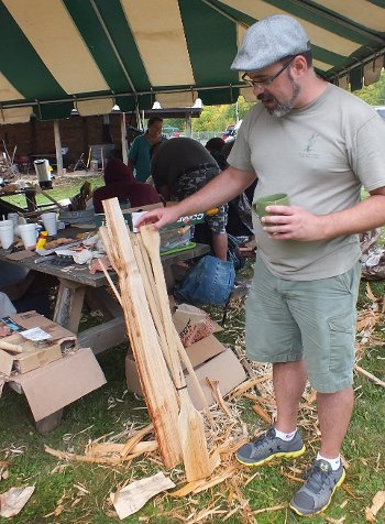 Rice camp teacher Scott Herron checks out the workmanship on a parching paddle during a tool-making session in Alberta, Michigan. Herron and co-teacher Roger LaBine lead weekend-long camps on all aspects of ricing.
