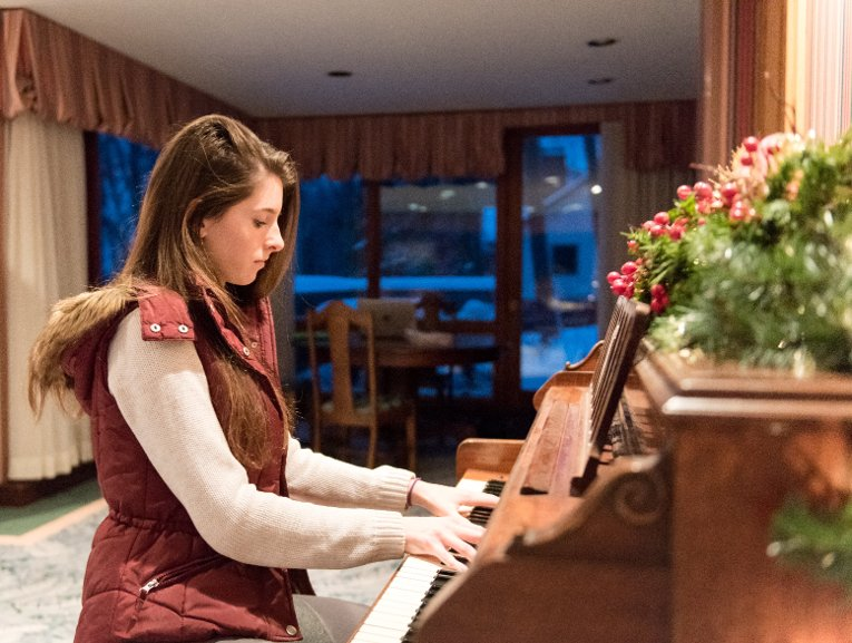Rose Turner likes the freshly tuned piano. Another favorite? Eating breakfast in the great room, watching the lake as the sun rises.