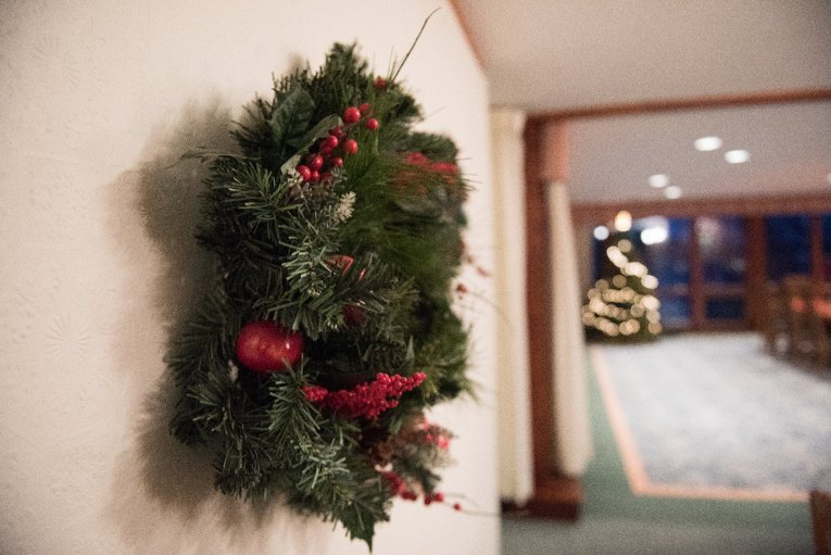 Like any other students on a budget, tenants repurpose what they found in the house, including holiday decorations. Every day they're implementing small and big changes, from replacing lightbulbs to powering up a solar array in the new year.