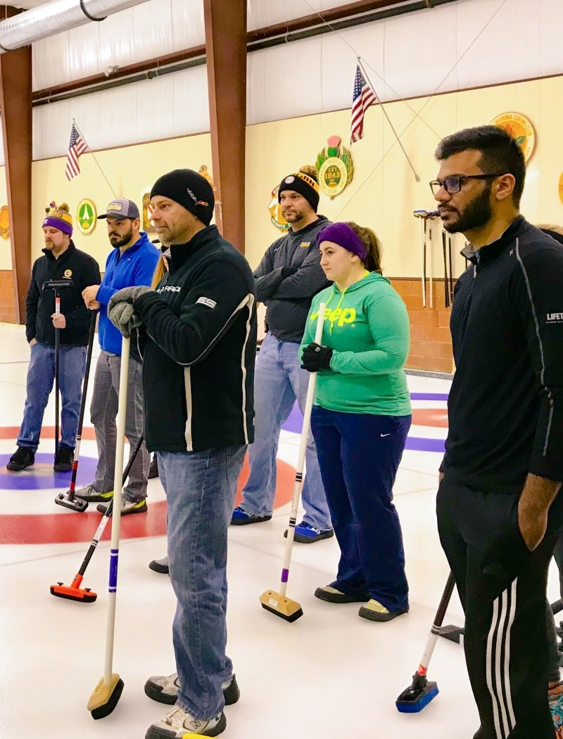 Michigan Tech alumni with curling sweepers