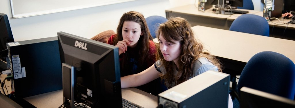 High school students working at a computer.