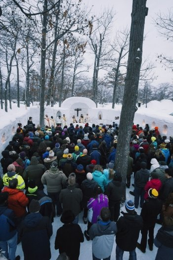 People in an outdoor snow chapel