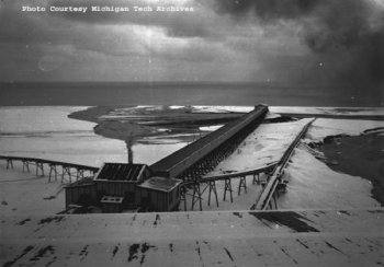 A historic photo of the sluiceway at Gay on the shore of the lake.